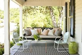 covered porch with black white chevron outdoor rug lime green garden stool glossy shutters swing and chevron indoor outdoor area rug