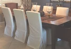 amazing custom parsons chair slipcovers and wooden dining table with gl hurricane candle holder centerpiece also tablecloth and interior paint ideas