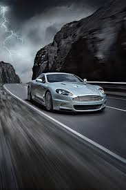 aston martin db9 iphone wallpaper. aston martin dbs on road iphone wallpaper and ipod touch background db9 iphone