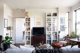 by flanking the television set with bookshelves williams gave it a built in appearance