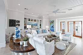 tropical beach living room with gray carpet and ceiling fan using recessed lights