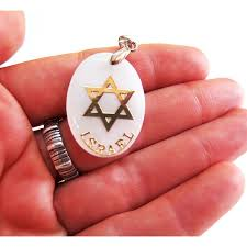 a pendant with a seashell with a symbol of star of david made in israel free