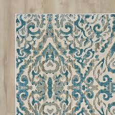 bungalow rose ya turquoise area rug for traditional living room decor
