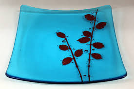 blue fused glass dish with copper design in the glass