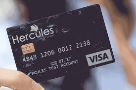 a hercules credit card transitioning to a couple walking on the beach