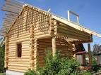 Фото домов из окоренного бревна