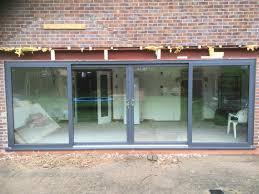 Kommerling Premiline Secured By Design 4 Pane sliding patio doors in Slate  grey RAL 7015.