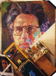 animated gif contrasting the painted portrait of eric by chuck close 1990 and the painting