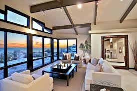 contemporary living room with boyd slipper chair exposed beam galala limestone high ceiling