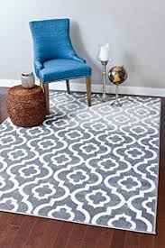 this moroccan trellis design features quatrefoils within quatrefoils it s available in gray white black white navy white turquoise white black burdy