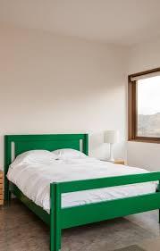 cozy blue black bedroom bedroom. Bedroom, Bedroom Minimalist Interior Black Vase With White Flower Olive Green Long Velvet Stool Plain Cozy Blue