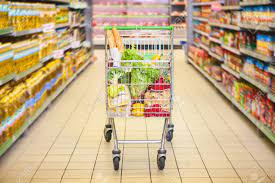 Trolley Full Of Products In Supermarket Stock Photo, Picture And Royalty  Free Image. Image 64273343.