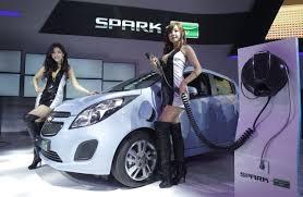 goyang south korea march 28 models pose next to a chevrolet spark ev