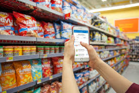 walmart store inside.  Store Customer Shops In Store Using Walmart App On Cell Phone On Store Inside