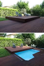 17 best ideas about wood deck designs deck design deck design idea this raised wood deck is actually a sliding pool cover contemporist