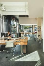 pduring the day this design studio looks like a typical workspace agency office literally disappears hours