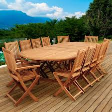 Highland park 13 piece teak patio dining set with folding chairs and 87 x 47 inch oval extension table by amazonia bbq guys