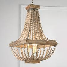 wood bead chandelier from romantic bedrooms to garden solarium spaces this wood bead chandelier helps amelie distressed chandelier perfect lighting
