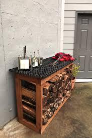 Love the metal grate on top log rack kit ideas. log rack outdoor firewood  storage ...