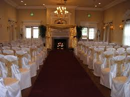 white chair covers with gold organza sashes