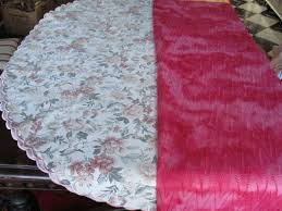 two tablecloths 1 x round cotton and 1 x rectangular polyester