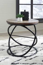 signature design charliburli round end table brown black t644 6