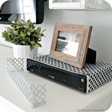 17 best ideas about hide tv cords hiding tv cords easy way to hide a cable box