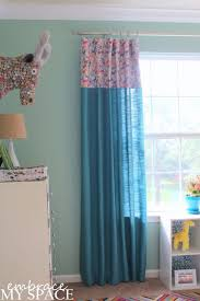 Nursery Curtains --- I'm thinking I'll do something like this with canvas  curtains (the cheap ones from Lowes/Home Depot) & a pop of color on the top!