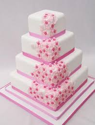 Four Tier Square White Wedding Cake With Pink Flowers And