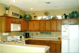 decor above kitchen cabinets. Top Of Cabinet Decor Lovely Above Kitchen How To Decorating Cabinets Interior .