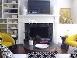 amazing transitional livingroom built ins collection of yellow black and white with shelf arrangement and hollywood regency and marble fireplace