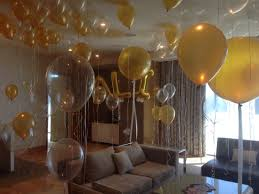 hotel room full of balloons for 21st birthday party balloon
