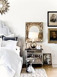 mirrored furniture room ideas. bedroom gallery wall in eclectic ideas with leopard print rug and sunburst mirror also mirrored narrow nightstand white bedding furniture room k