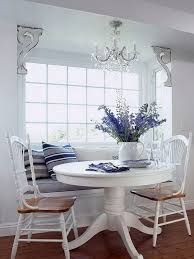 breakfast nook with a window seat and a round table