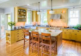 yellow country kitchens. Perfect Country Decor Yellow Kitchen Cabinets With Traditional  And A Contrasting Wood Island For Country Kitchens