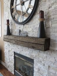 beautiful stone veneer surround for gas fireplace with rustic wood mantel detail by m v contractors