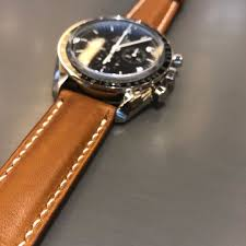 handmade handstitched watch strap in hermès golden barenia leather for his omega sdmaster luxury watches on carou