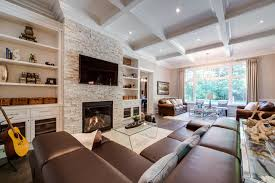 family room fireplace ideas. large elegant open concept medium tone wood floor and brown family room photo in toronto fireplace ideas c