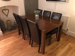 solid dark wood dining table 6 chairs