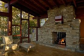 ledgestone fireplace room divider with stone fireplace mantel exposed wood beam ceiling framed floor to ceiling