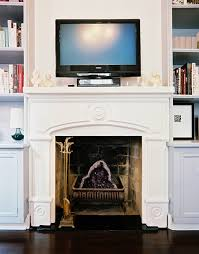 tv above fireplace photos 1 of 2