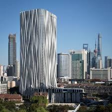 office facade. Kengo Kuma Dresses Shanghai Tower In Pleated Aluminium For Soho China Office Facade