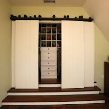 santa barbara barn style closet traditional with doors metal coat hooks raised