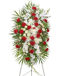 graceful red white standing spray of funeral flowers