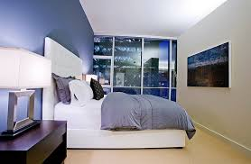 view in gallery use lighting to alter the shade of the blue in the bedroom in a subtle fashion