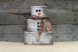 zoom on primitive christmas wall art with rustic wooden snowman christmas decor block snowman