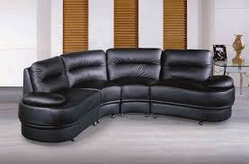 half round shape black leather sofa and glass tabled beside for modern living room interior design