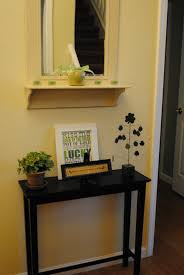 vintage entry table. Chic Wall Mirror And Small Entryway Table With Home Accessories For Design Also Interior Paint Color Baseboard Door Casing Plus Narrow Vintage Entry A