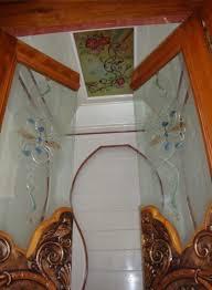 glass door with wooden frame pooja room door designs