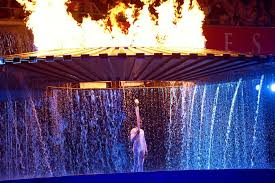 flame lighting olympics. the olympic cauldron rises over australian athlete cathy freeman at opening ceremony in sydney. flame lighting olympics g